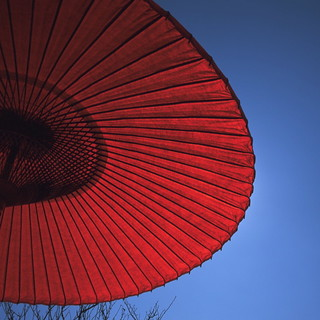 Red umbrella against sky | by Joi