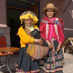 beautiful dressed native people on the market of Pisaq - Peru