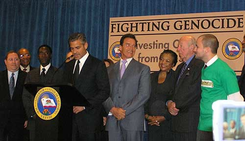 Arnold Schwarzenegger, George Shultz, Don Cheadle, George Clooney and activist Adam Sterling at the California divestment bill signing | by Genocide Intervention Network