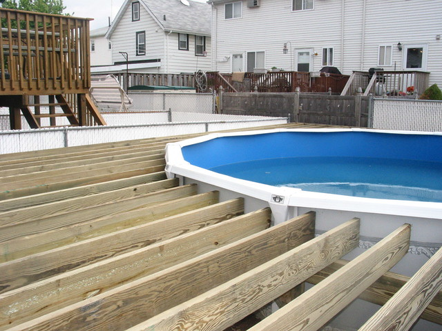 Deck around a pool deck frame built around a pool - How to build an above ground swimming pool ...