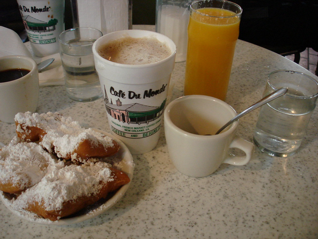 Beignets And Coffee At Cafe Du Monde