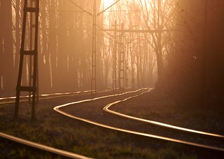 The sun sets on the tramline by the Nowa Huta steelworks | by closelyobservedphoto