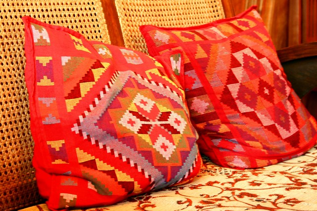 Unan Pillows With Ethnic Design On A Wooden Sofa