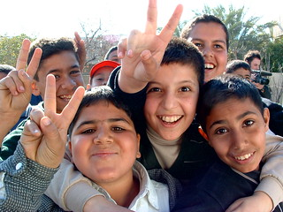 Iraqi boys giving peace sign | by Christiaan Briggs