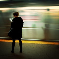 On the platform, reading | by moriza