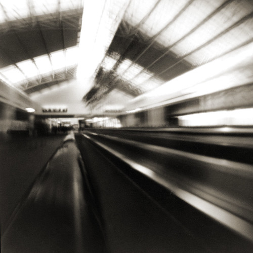 pinhole encounters lightspeed at the moving walkway | by manyfires