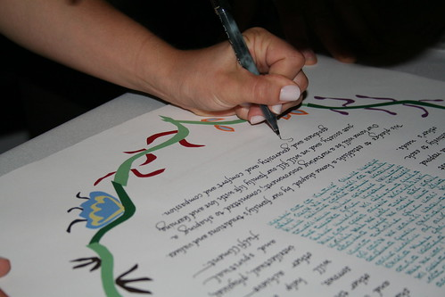 Sarah signs the ketubah | by santheo
