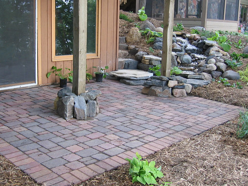 Waterfall and paver patio | by Field Outdoor Spaces