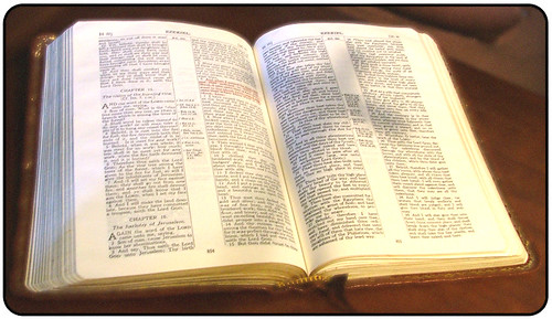 Bible with Cross Shadow | by knowhimonline