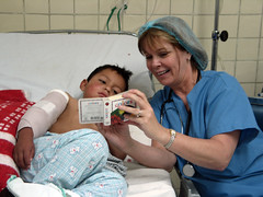 PACU Nurse Tina Cerruti Reading to a Post-op Patient