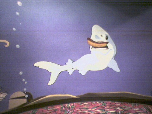 shark eating a hot dog