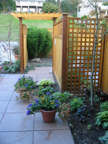 Entry gate and decorative privacy fence this is a job for Lattice garden fence designs
