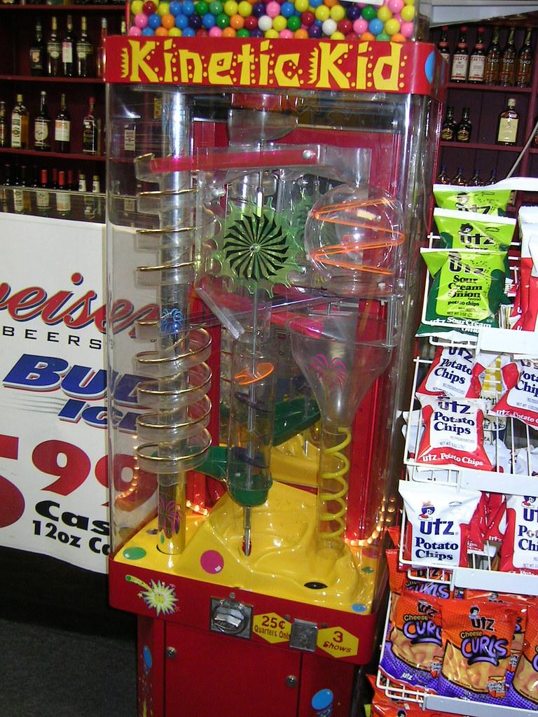kinetic kid a gum ball machine in a liquer store a