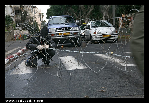 Direct Action against the wall and restrictions of movements in Palestine, Anarchists Blocking Rotchield street in Tel Aviv, Israel, 03/02/07 | by Activestills
