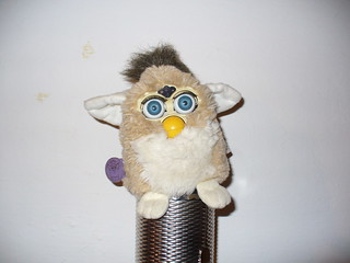 Troubled Furby standing on top of a metal guiro | by canceledmodillion