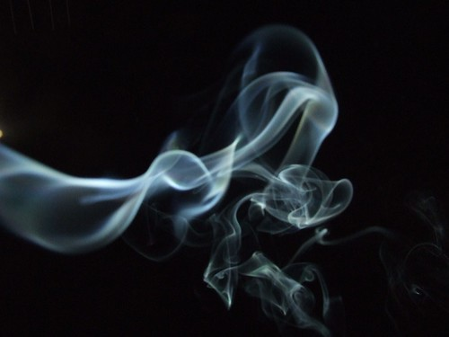 Incense smoke against a black sky | by Vanessa Pike-Russell