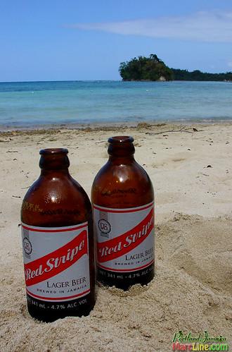 Red Stripes On San San Beach Iriest Beer Dranked In Port