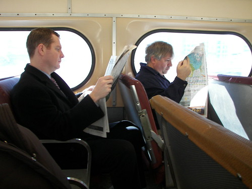 Reading newspapers on a Septa regional passenger train