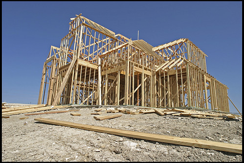 Mchouse under construction a cookie cutter house under for Home under construction insurance