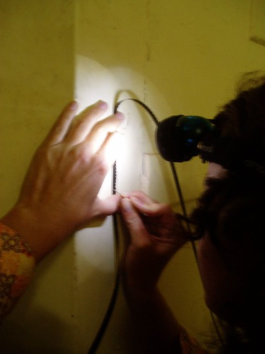 Vicki Smith scratching an improvised version of Line Describing a Cone on a bit of black super8 leader! | by bilateral