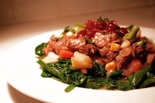 Wild reindeer stew on a bed of lemon sauteed spinach | by hazymat