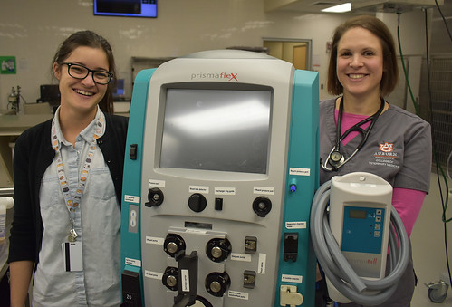 Dr. Katherine Nash and Dr. Lenore Bacek are shown with a dialysis machine.