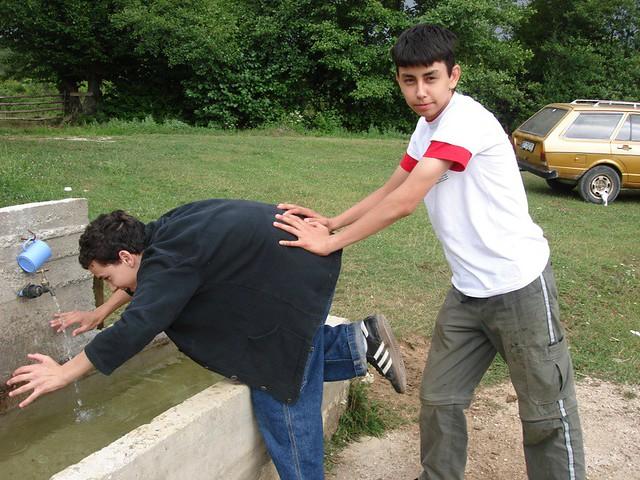 Image result for man pushing kid