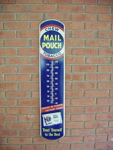 Mail pouch thermometer hanging on a brick wall in for Poolthermometer obi