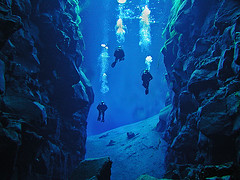 Divers in Silfra | by Icelandic images
