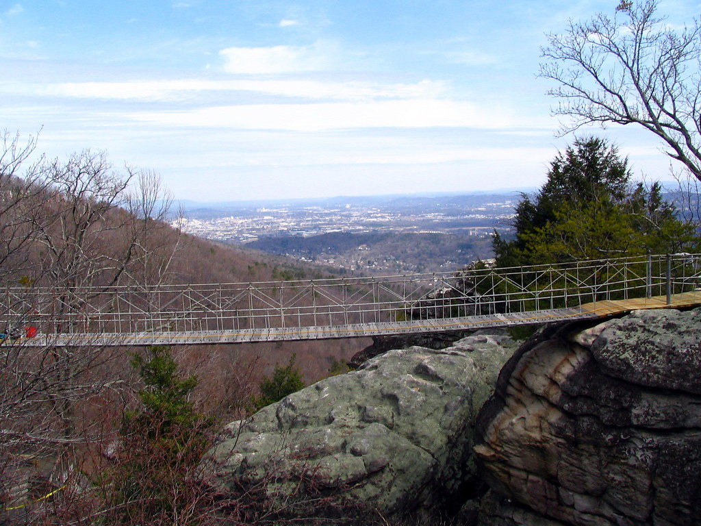 The Rock City Swinging Bridge With The City Of