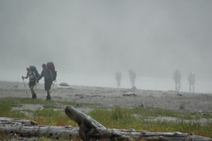 hikers in mist | by Mountain Hardwear