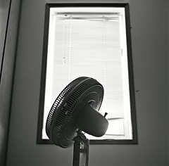 Fan in front of window | by Drew Larson