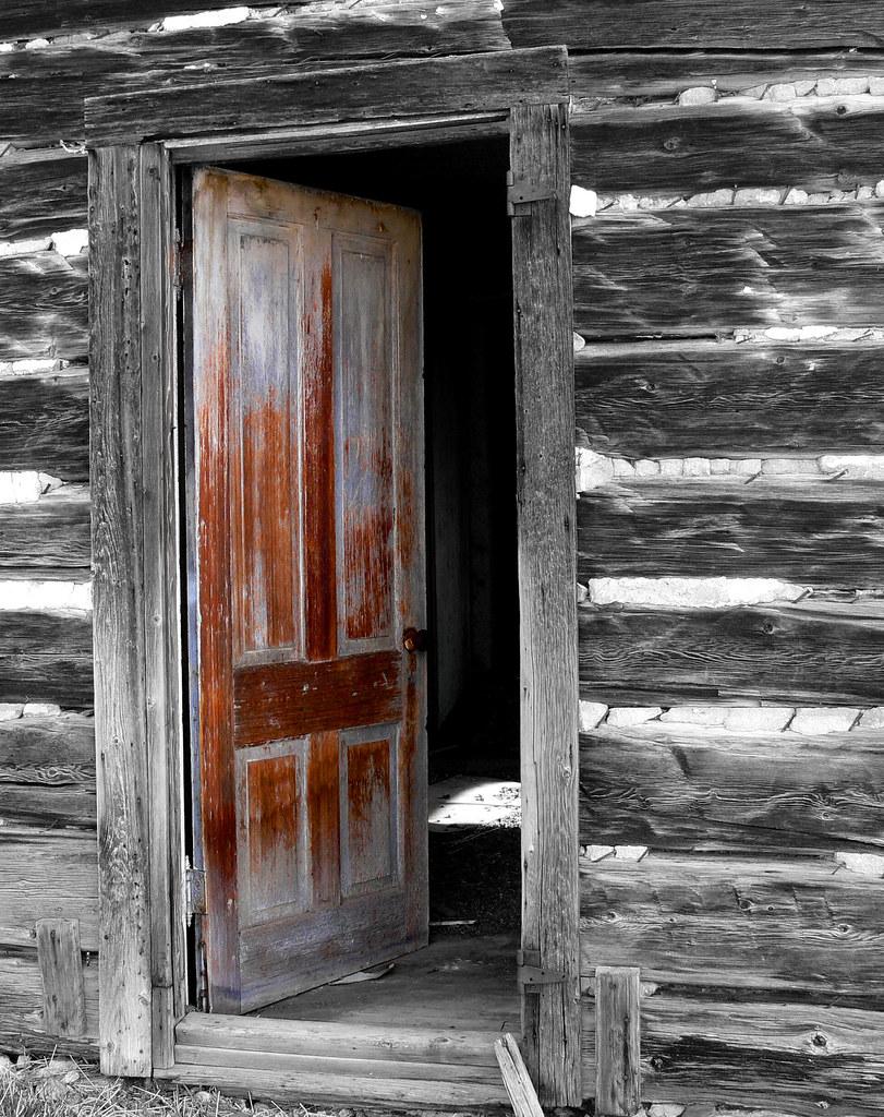 Old open door an old door in an abandoned log house for New door photos