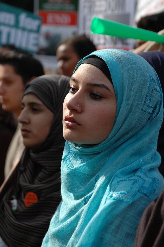 Young British Muslim Girls Listening Attentively To The Sp -9975