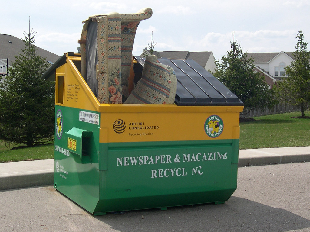 trashy old couch newspaper magazine recyling dumpster flickr. Black Bedroom Furniture Sets. Home Design Ideas