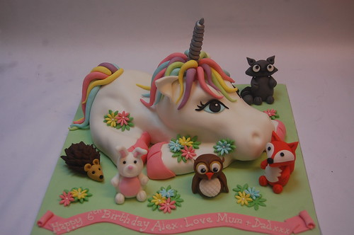 We've done a simpler version of this before but love the addition of some woodland friends for the unicorn! The Unicorn Cake with woodland animals - from £90.