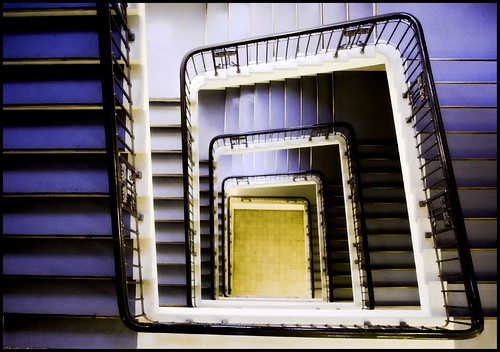 spiral staircase with a yellow floor (looking down) | by POSITiv