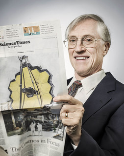 DR. JOHN C. MATHER reading news article on Webb Telescope