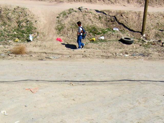 boy walking alone on road - photo #24