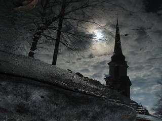 A church's reflection in a melting snowbank... | by hawkryger (www.augustkryger.com)