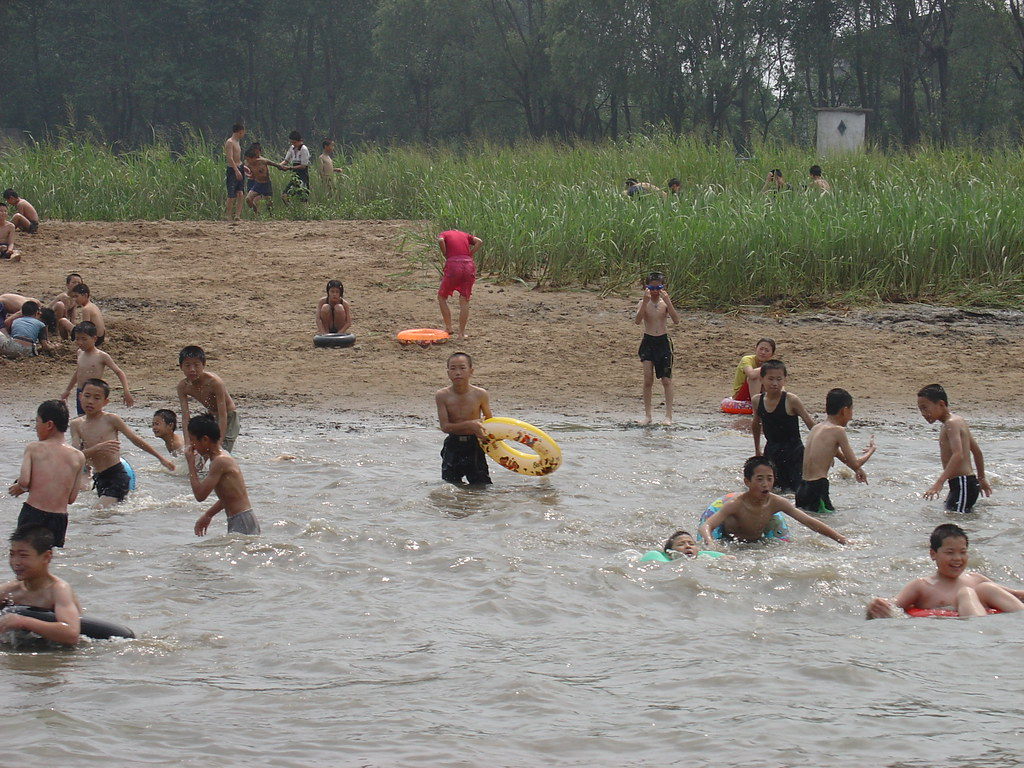 North Korean Children Swimming in the Yalu River ...