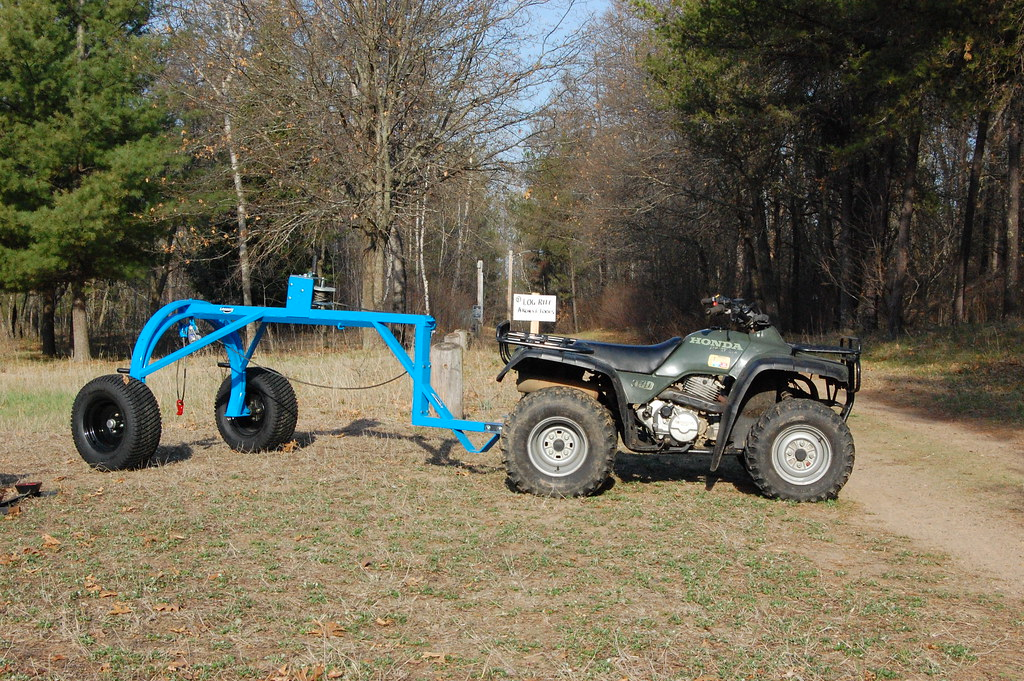 Atv With Log Arch As More And More Forested Parcels Are
