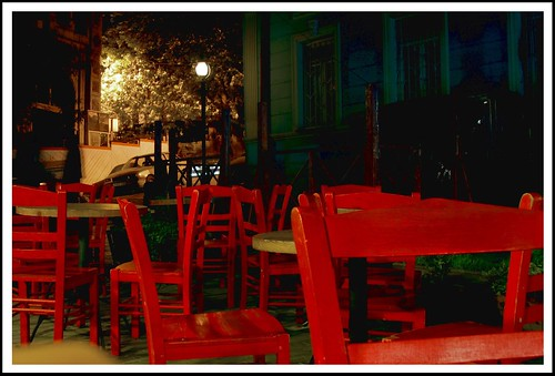 a few red chairs late at night | by shioshvili