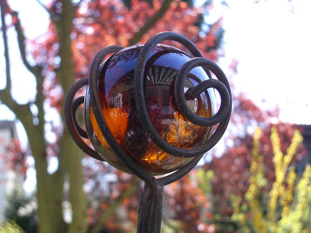 Metal sculpture with glass sphere