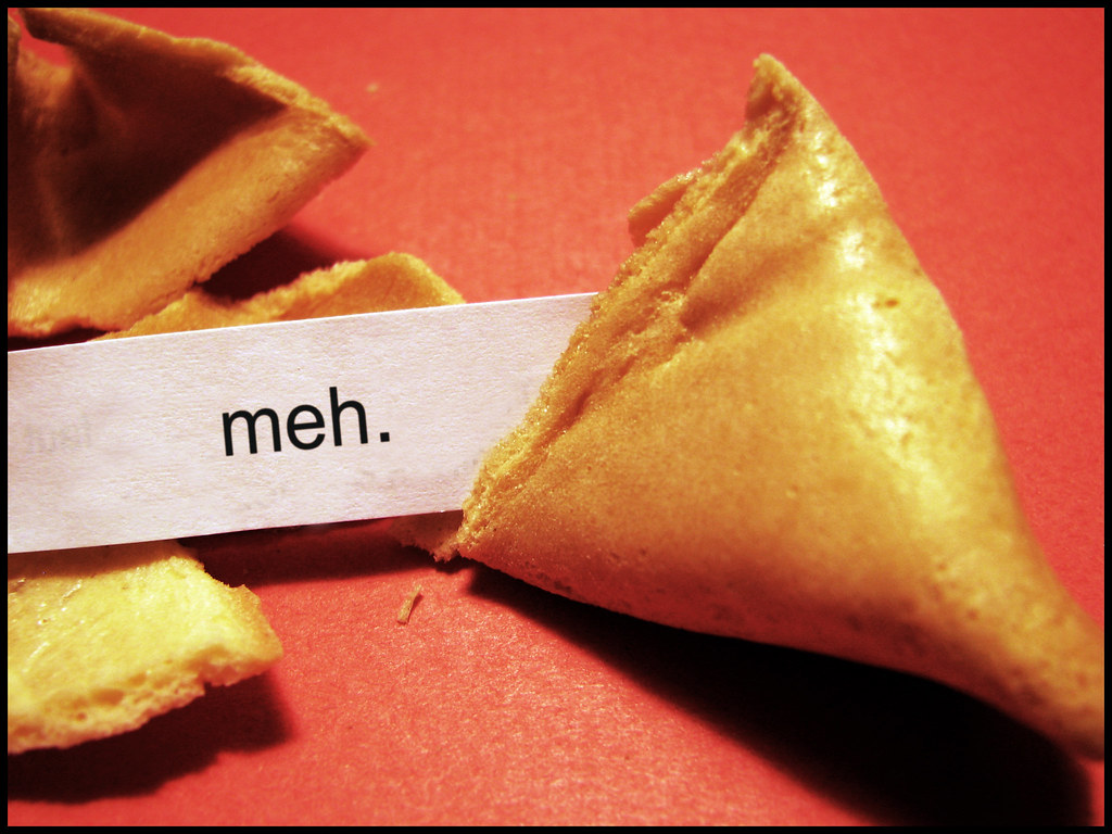 A fortune cookie is cracked open to reveal the word