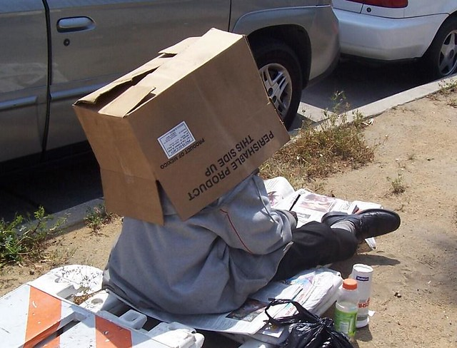 homeless man wearing a box on his head this was not staged flickr. Black Bedroom Furniture Sets. Home Design Ideas