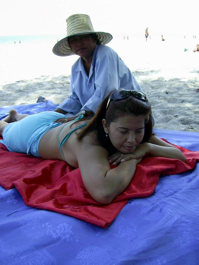 Hua Hin Massage 2  Aw getting a back massage on the beach ...