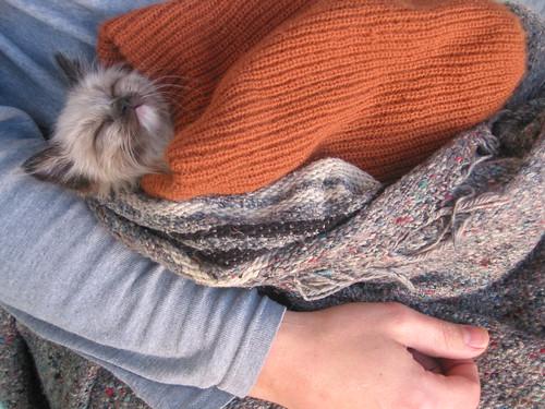 charlene in a stocking cap/sleeping bag