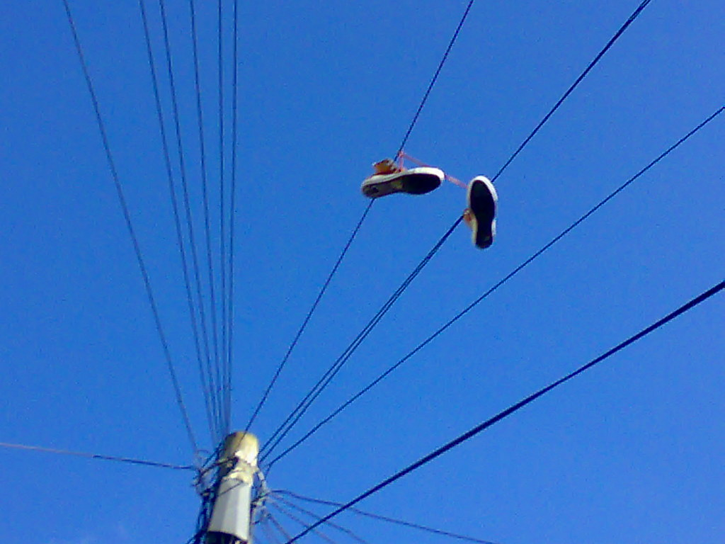 Shoes hanging from a telephone wire i 39 m going to start a for Hang photos from wire