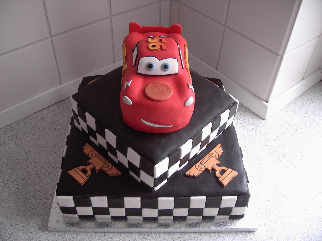 Lightning McQueen A 3D birthday cake shaped like ...